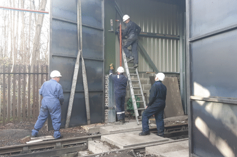 a door being lifted into place