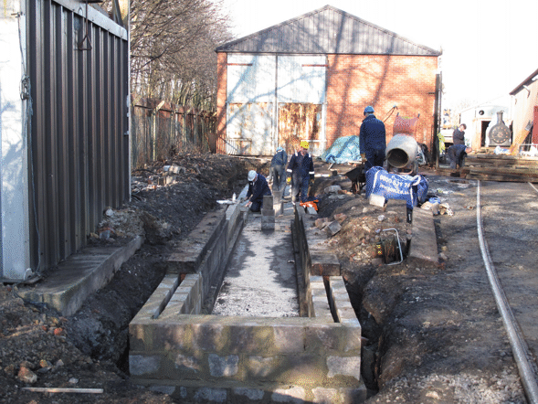 The pit blockwork partly built