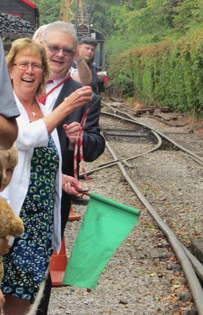 Judith Blake signalling to the locomotive drivers